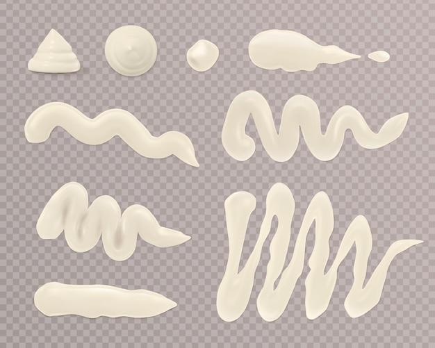 Zestaw białych plam z majonezu na białym tle