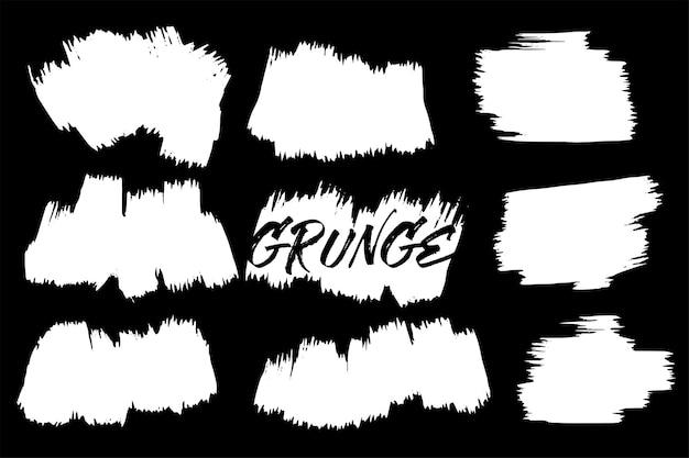 Zestaw białych pociągnięcia pędzlem tekstury grunge