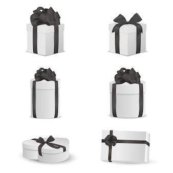 Zestaw białych pudeł z czarnymi kokardkami i wstążkami.