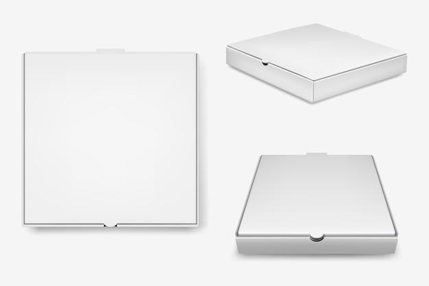 Zestaw białych pudełek po pizzy.
