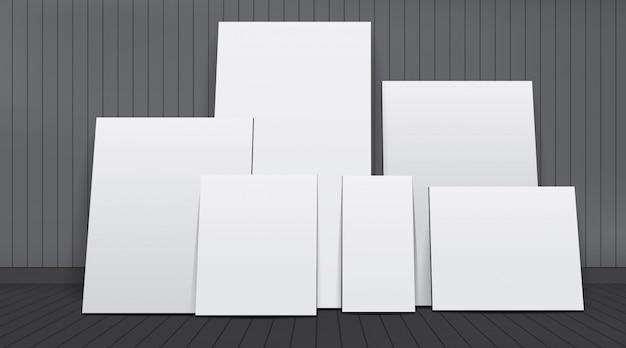 Zestaw białych pustych ramek do zdjęć w pokoju.