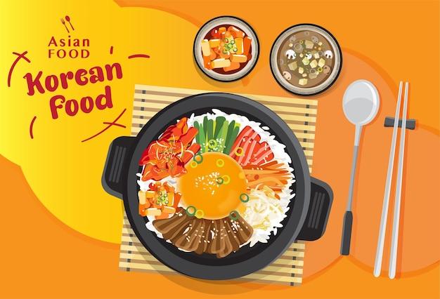 Zestaw bibimbap kuchni koreańskiej, mieszanie ryżu z różnymi składnikami w czarnej misce, ilustracja widok z góry