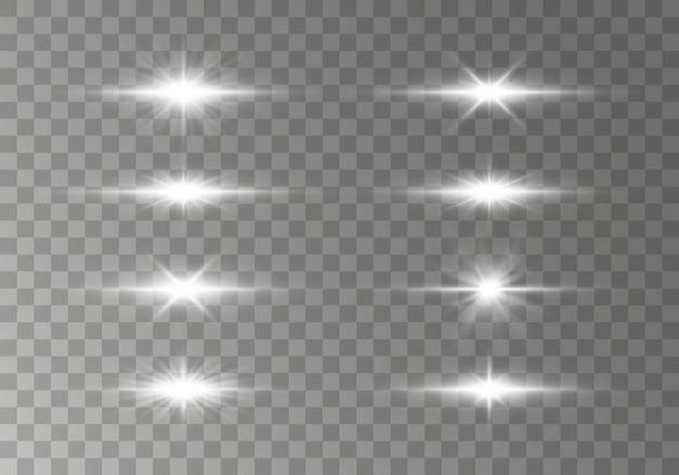 Zestaw błysków, świateł i błysków na przezroczystym tle. jasne promienie światła. świecące linie.