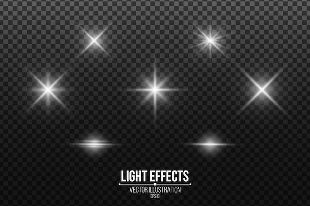 Zestaw błyszczących gwiazd. efekty świetlne na białym tle. białe odblaski i flary.