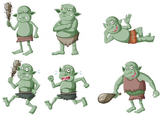 Zestaw ciemnozielony goblin lub troll w różnych pozach w postać z kreskówki na białym tle