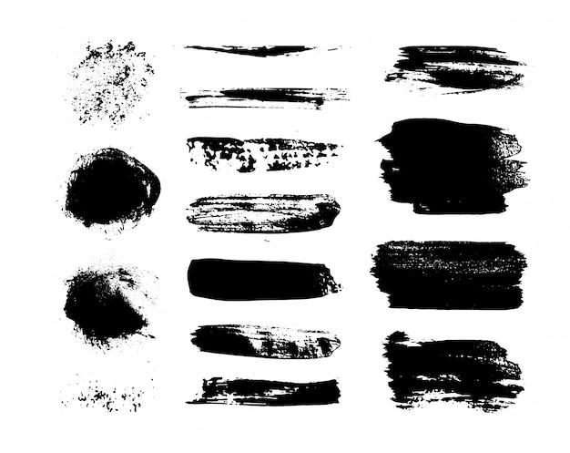 Zestaw czarnej farby, pociągnięć, pędzli. elementy dekoracyjne