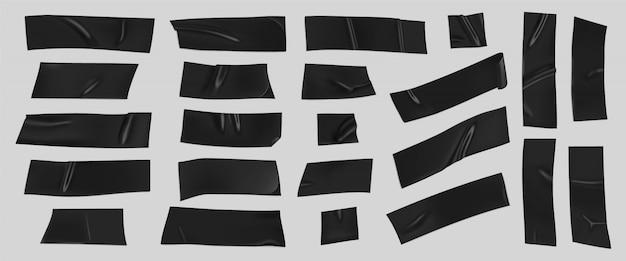 Zestaw czarnej taśmy klejącej. realistyczne kawałki czarnej taśmy samoprzylepnej do mocowania na białym tle