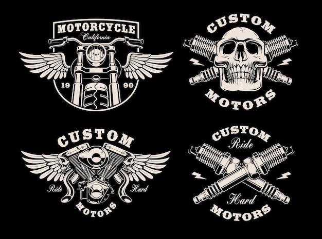 Zestaw czarno-białych emblematów motocyklowych na ciemno