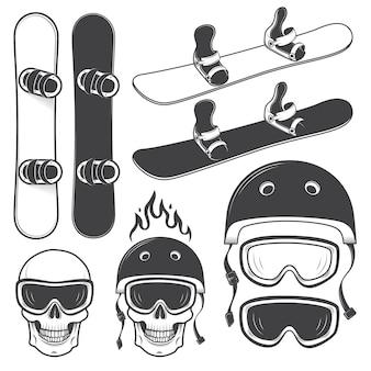 Zestaw czarno-białych snowbordów oraz zaprojektowane elementy snowboardowe. temat ekstremalny, sporty zimowe, przygoda na świeżym powietrzu.