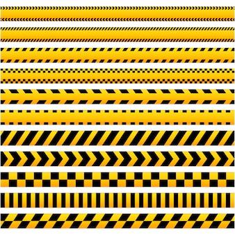 Zestaw czarnych i żółtych taśm ostrzegawczych