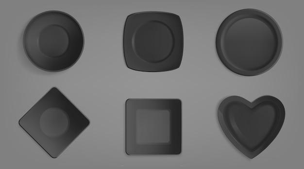 Zestaw czarnych misek o różnych kształtach.