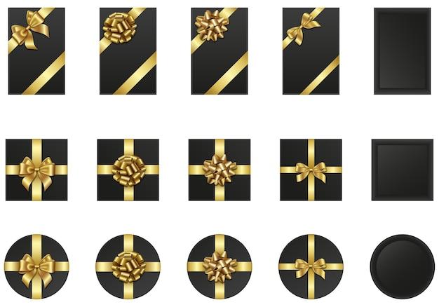 Zestaw czarnych pudełek prezentowych ze złotymi kokardkami i wstążkami. elementy czarnego piątku