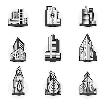 Zestaw czarnych wieżowców i fasad budynków.