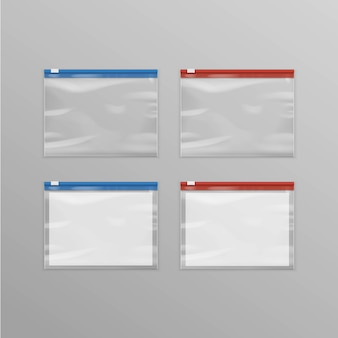 Zestaw czerwony niebieski zapieczętowane puste przezroczyste plastikowe torby na zamek błyskawiczny z bliska na białym tle na tle