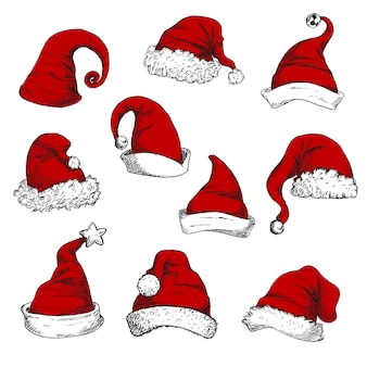 Zestaw czerwonych czapek świętego mikołaja. elementy dekoracji nowego roku i świąt.
