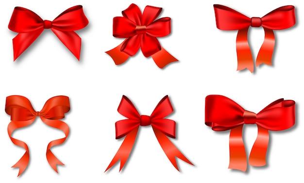 Zestaw czerwonych kokardek prezentowych ze wstążkami.