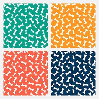Zestaw czterech kolorowych bezszwowych wzorów z białymi kośćmi