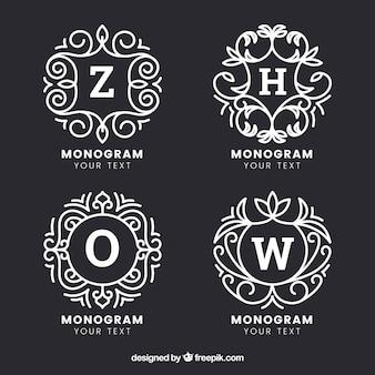 Zestaw czterech rysowanych ręcznie monogramów