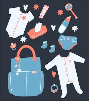 Zestaw dla dziecka z torbą, serwetkami, pieluchami, grzechotkami, ubraniami, butelką, kremem.