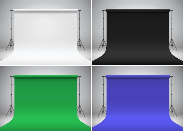 Zestaw do fotografowania z kluczem chroma stojący na szarym tle zestaw różnych kolorowych teł studyjnych