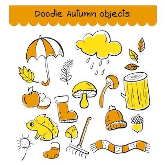 Zestaw doodle obiektu jesień w kolorze pomarańczowym i żółtym.