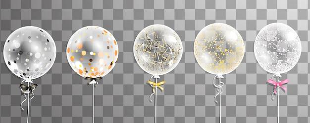Zestaw dużych przezroczystych z konfetti balony helowe na przezroczystym tle. dekoracje na urodziny, rocznicę, uroczystości.
