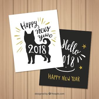 Zestaw dwóch kart wyciągnąć rękę nowego roku z psem