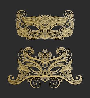 Zestaw dwóch złotych przebiegłych weneckich karnawałowych koronkowych masek sylwetki