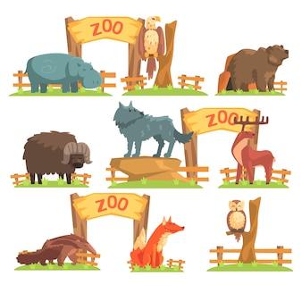 Zestaw dzikich zwierząt za płotem w zoo