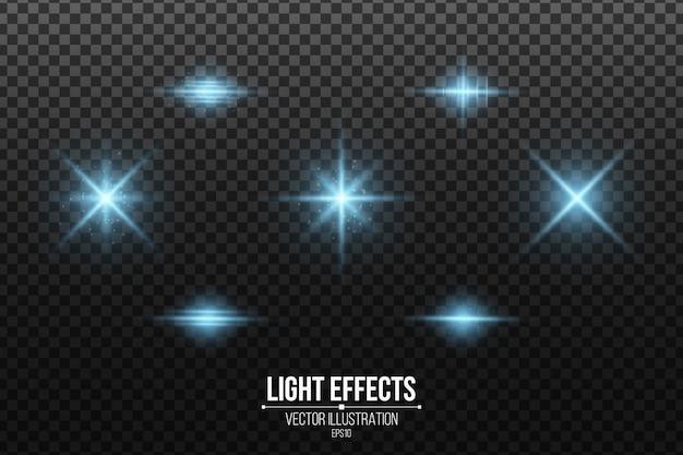 Zestaw efektów niebieskiego światła na białym tle. lśniące gwiazdy i świecący pył. błyszczące elementy.