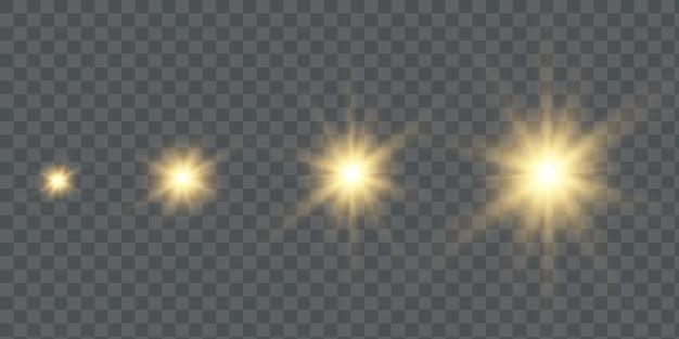 Zestaw efektów złotych świecących świateł na przezroczystym tle. błysk słońca z promieniami i reflektorem. efekt blasku.