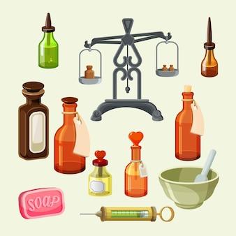 Zestaw elementów aptekarza farmaceutycznego. realistyczne butelki na olejki eteryczne i produkty kosmetyczne, strzykawka, wagi do wydawania leków. zabytkowe słoiki, butelki z zakraplaczem, mydło i naczynia.