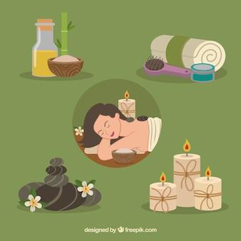 Zestaw elementów centrum spa ze świecami i olejkami aromatycznymi