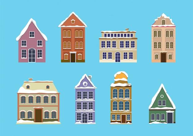 Zestaw europejskich kolorowych starych domów ze śniegu. płaska konstrukcja