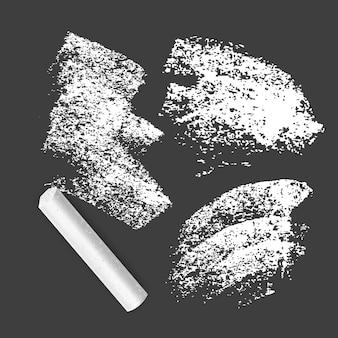 Zestaw grunge tekstur utworzony kredą w kolorze białym.