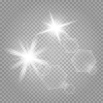 Zestaw gwiazd. białe świecące światło wybucha na przezroczystym.