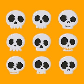 Zestaw ikon czaszki halloween kreskówka na białym tle na pomarańczowym tle