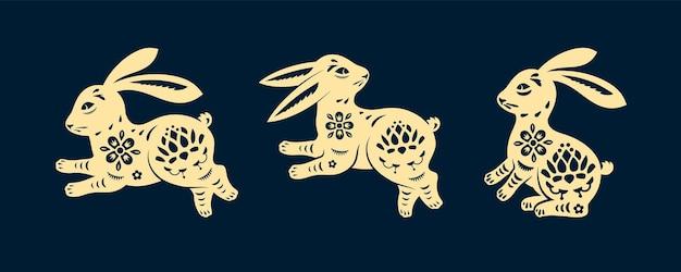 Zestaw izolowanych królików w dekoracji króliczka w stylu cięcia papieru na wielkanocną ikonę zająca lub