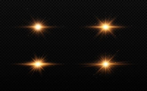 Zestaw jasnej gwiazdy złote świecące światło eksploduje na przezroczystym tle.