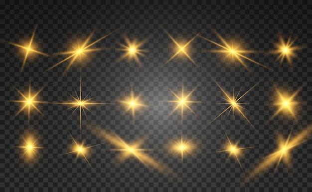 Zestaw jasnych, pięknych gwiazd. efekt świetlny. jasna gwiazda. piękne światło do ilustracji. gwiazda bożonarodzeniowa. białe iskierki błyszczą specjalnym efektem świetlnym. błyszczy na przezroczystym tle.