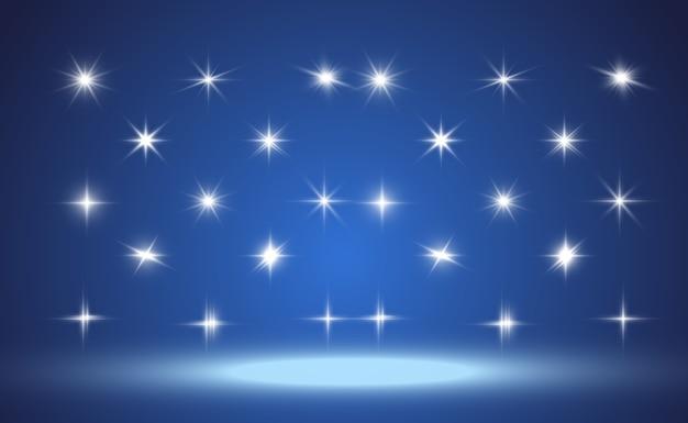 Zestaw jasnych pięknych gwiazd. efekt świetlny. jasna gwiazda. piękne światło do zilustrowania. gwiazda. biały brokat mieni się ze specjalnym efektem świetlnym. błyszczy na przezroczystym tle.