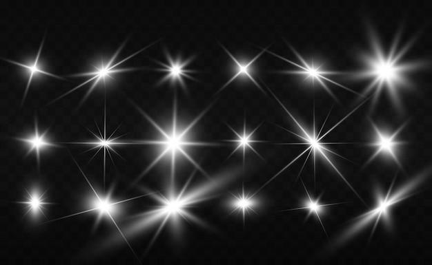 Zestaw jasnych, pięknych gwiazd. efekt świetlny. jasna gwiazda. piękne światło do zilustrowania. gwiazda bożego narodzenia. biały brokat błyszczy ze specjalnym efektem świetlnym. wektor błyszczy na przezroczystym tle.