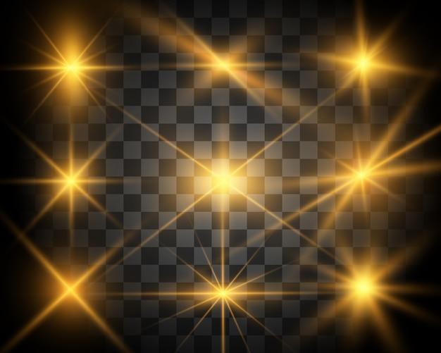 Zestaw jasnych pięknych gwiazd. efekt świetlny. jasna gwiazda. piękne światło do zilustrowania. gwiazda bożego narodzenia. biały brokat mieni się ze specjalnym efektem świetlnym. błyszczy na przezroczystym tle.