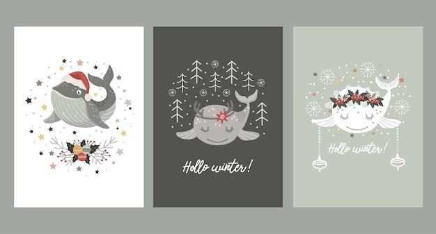 Zestaw kartek świątecznych z małym wielorybem w czapce mikołaja, w wieńcu z zimowego bukietu oraz z rogami jelenia.