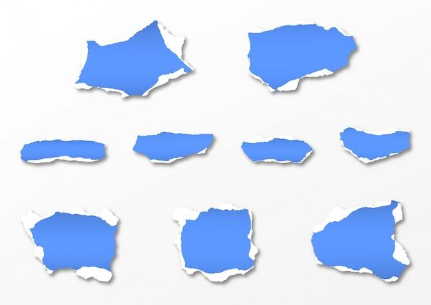 Zestaw kawałków rozdartego papieru