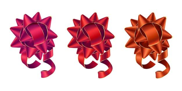 Zestaw kolorowych błyszczących kokardek w odcieniach czerwieni na białym tle