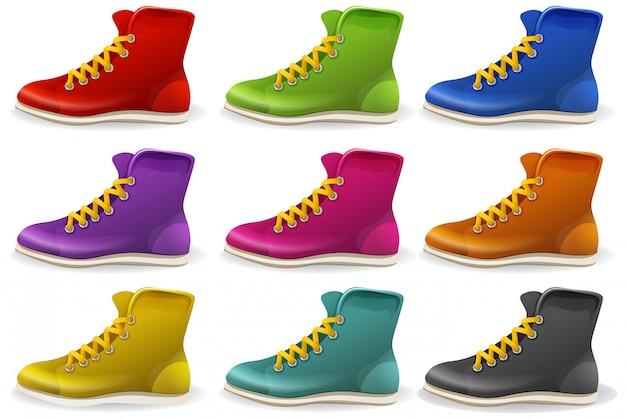 Zestaw kolorowych butów i pokazuje na białym tle