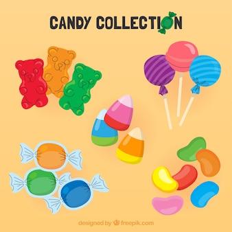 Zestaw kolorowych cukierków w stylu płaski