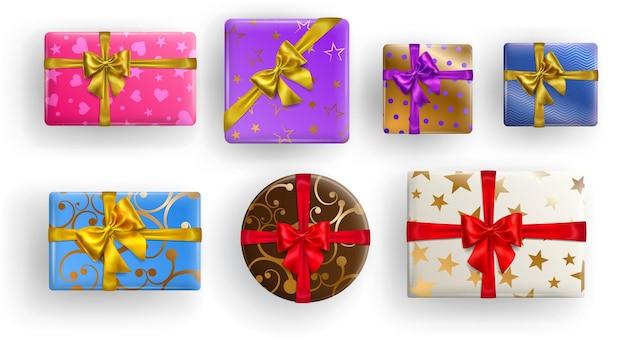 Zestaw kolorowych pudełek na prezenty w kształcie kwadratu, prostokąta i koła ze wstążkami, kokardkami i różnymi wzorami