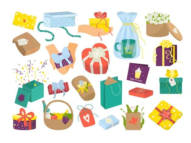 Zestaw kolorowych pudełek z kokardkami i wstążkami na białym tle. przedstawia